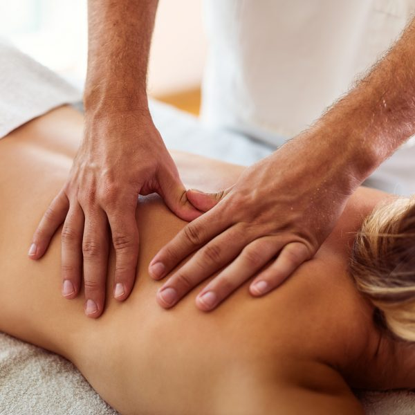Shot of a woman getting a back massage at a spa.